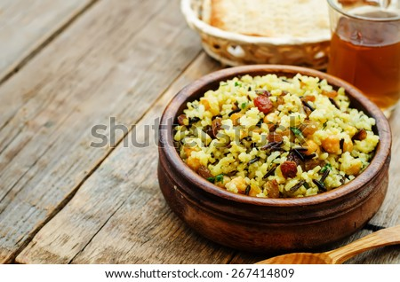 rice, wild rice, chickpeas with raisins and herbs on a dark wood background. the toning. selective focus - stock photo
