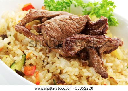 Rice with Beef, Cabbage, Mushrooms and Paprika - stock photo