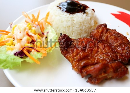 Rice with chicken grill with salad.  - stock photo