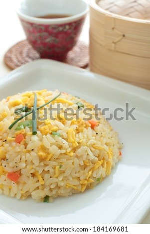 Rice with eggs, carrots, and green vegetables in it. - stock photo