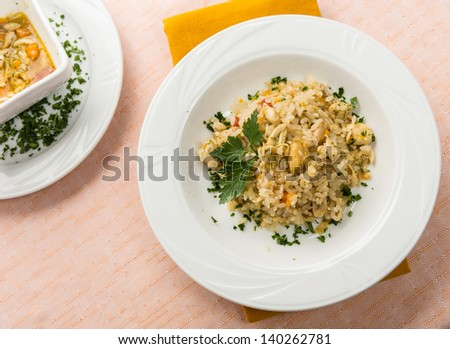 Rice with frogs in white dish - stock photo