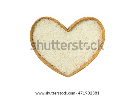 Rice with heart shaped isolated on white background.