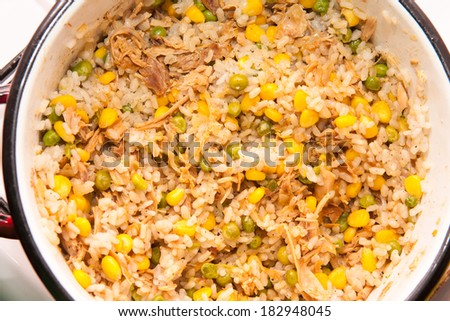 Rice with meat and vegetables in the pot - stock photo