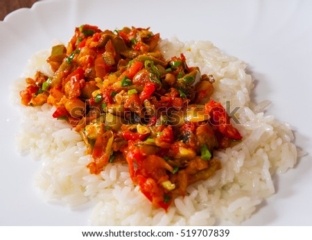 Rice with mixed vegetables on white plate