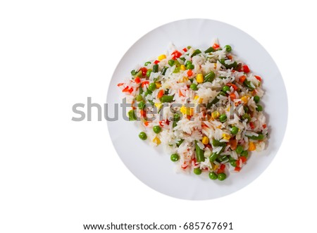 Rice with mixed vegetables on white plate. top view. isolated on white