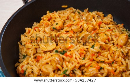 rice with mushrooms in a frying pan