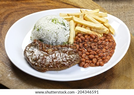 Rice with potatoes and meat. - stock photo