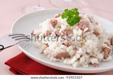 Rice with sausage on white dish