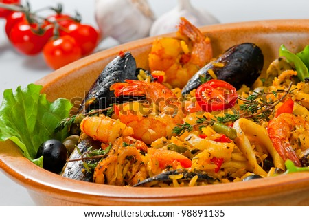 rice with seafood close up in a dish - stock photo