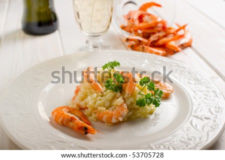 rice with shrimp and glass of white wine