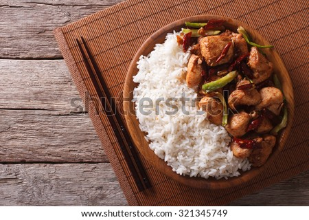 Rice with spicy kung pao chicken on a plate. horizontal view from above - stock photo
