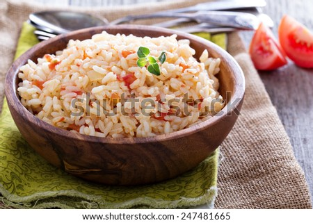 Rice with tomatoes and onions healthy side dish - stock photo