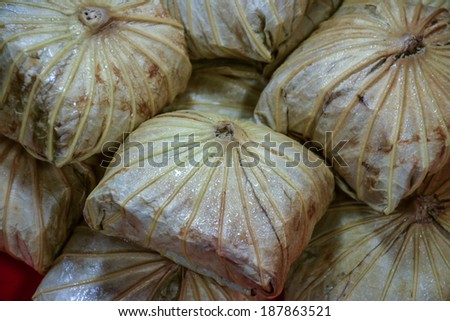 Rice wrapped in lotus leaves, large and overlapping.