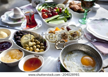 Rich and delicious Turkish breakfast on a round table - stock photo