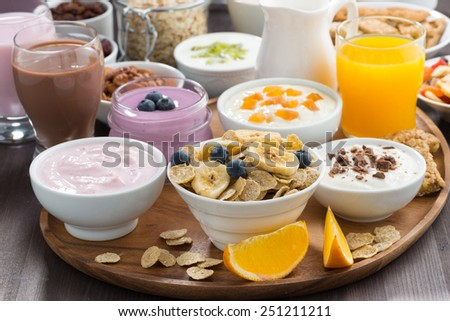 rich breakfast buffet with cereals, yoghurt and fruit, horizontal - stock photo