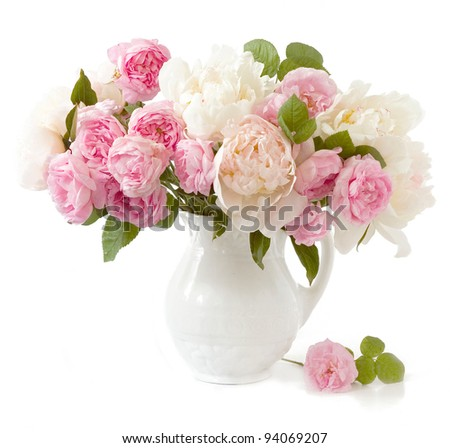 Rich bunch of peonies and tea roses in vase isolated on white - stock photo