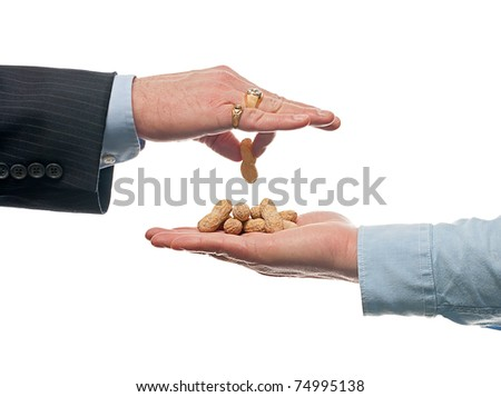 Rich business man underpaying worker - stock photo