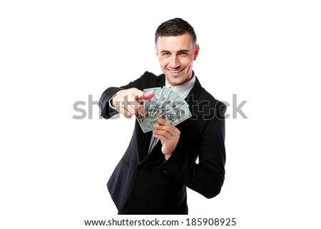Rich businessman holding US dollars and showing on you isolated on a white background - stock photo
