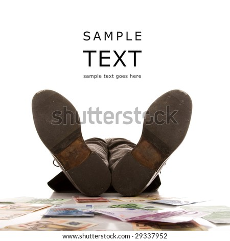 rich businessman relaxing over a lot of money (selective focus) - stock photo
