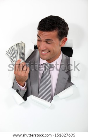 Rich businessman showing off his money - stock photo