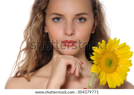 Rich close-up portrait of a beautiful girl with perfect clean skin with sunflower in her hand isolated on white - stock photo
