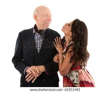 Rich elderly man with Hispanic gold-digger companion or wife - stock photo