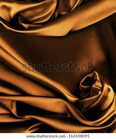 Rich gold silk background with place for text