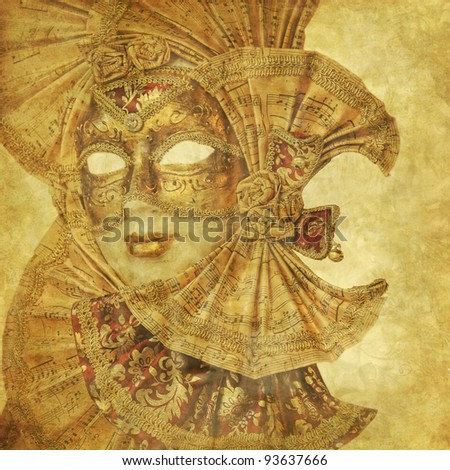Rich golden Venetian Mask on floral grunge wallpaper with music sheet decoration - stock photo