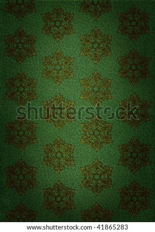 Rich, green leather decorated with a antique gold snowflake pattern, suitable for use as a background texture. - stock photo
