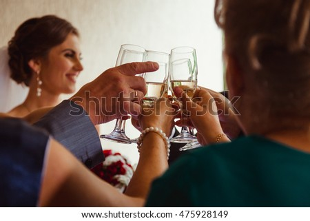 Rich guests clang glasses with champagne