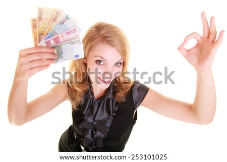 Rich happy blonde business woman showing euro currency money banknotes, giving ok hand sign gesture. Economy, finance business work. - stock photo