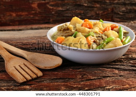 Rich Hearty Beef Stew Ready To Serve On Wooden Background