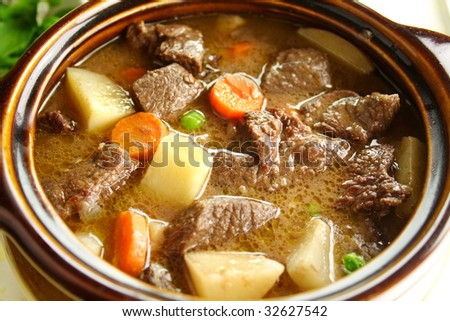 Rich hearty beef stew simmering and ready to serve. - stock photo