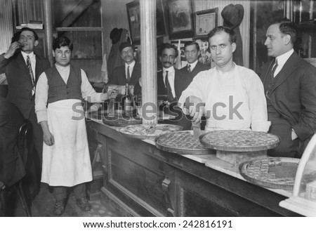 Rich pastries on display in a Lebanese-Syrian restaurant in New York City. Many immigrants opened small businesses, including restaurants in their ethnic communities. Ca. 1910.