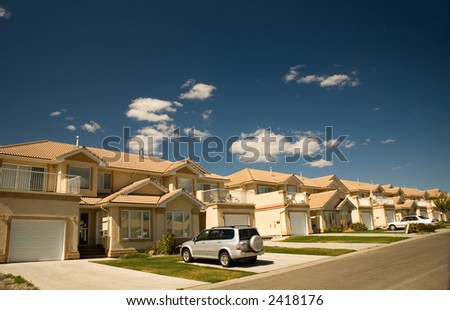 Rich people living in very similar housing. - stock photo