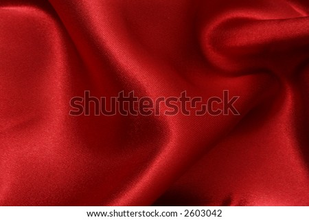 Rich red satin fabric background, diffused slightly for a softer appearance - stock photo