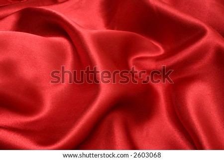 Rich red satin fabric background, diffused slightly to give a slightly softer appearance - stock photo
