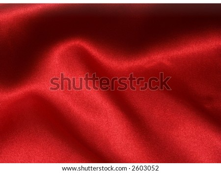 Rich red satin fabric background, diffused slightly to give a softer appearance - stock photo