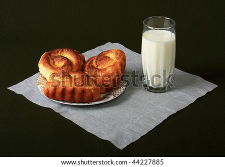 Rich rolls with milk, tasty meal - stock photo