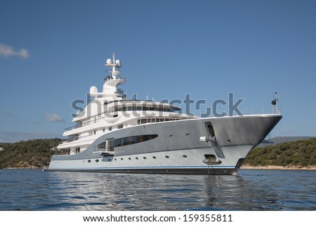 Rich - side view of luxury yacht on the Mediterranean Sea   - stock photo