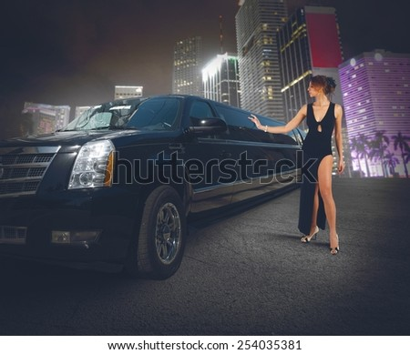 Rich woman touches and admires her limousine - stock photo