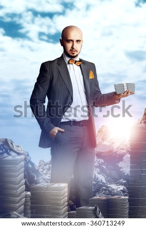 rich young man in a business suit with a bunch of money. Business concept - stock photo