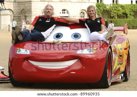 "Richard and Holly Branson launch the ""Cars 2"" and Marussia Virgin Racing partnership at Horse Guards Parade, London  04/07/2011 Picture by: Steve Vas / Featureflash"