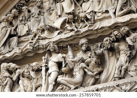 Richly carved on the facade of the church of Visegrad in Prague. Above the door of the Catholic Cathedral there are scenes with a lot of people made in stone - stock photo