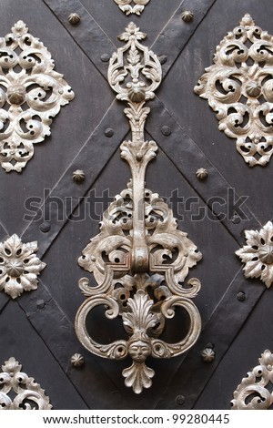 richly decorated doors with wrought iron, and knocker - stock photo