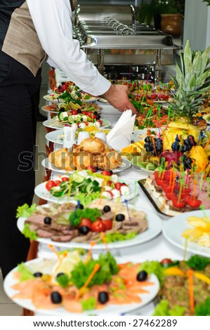 richly served banquet table - stock photo