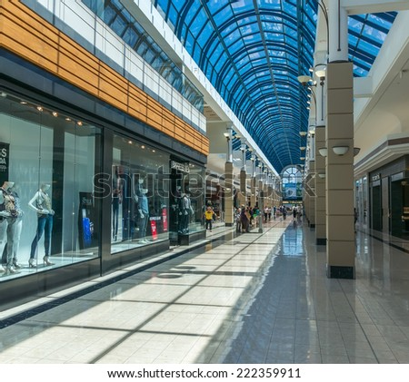 RICHMOND, BC, CANADA - JULY 17, 20014 - People can be seen inside the Richmond Centre. With over 230 stores and services, Richmond Centre is one of the Lower Mainland's best shopping experiences. - stock photo