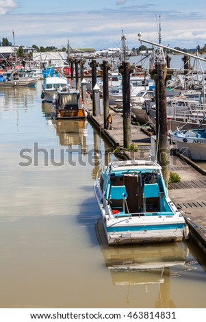 RICHMOND, CANADA - JULY 10: Colorful boats and trawlers dock at the picturesque  seaside village of Steveston Fisherman's Wharf in Richmond near Vancouver July 10, 2016.