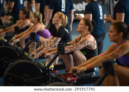 RICHMOND, CANADA - JUNE 7, 2013: Athletes compete during CrossFit tournament, June 7, 2013 in Richmond, BC, Canada.  - stock photo
