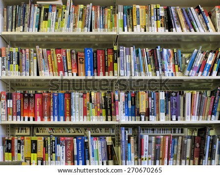 RICHMOND HILL - NOV 29: Technical and computer related books are displayed on library shelves and photographed on November 29, 2008. - stock photo